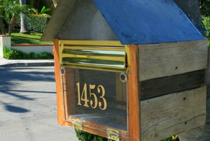 A mailbox made from reclaimed wood.