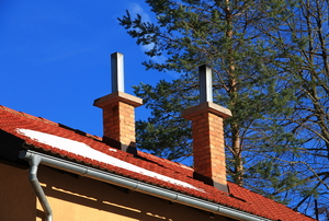 roof with chimneys and an aluminum gutter
