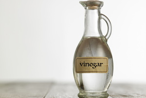 A container of vinegar.