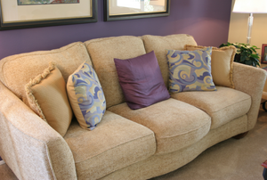beige couch with throw pillows