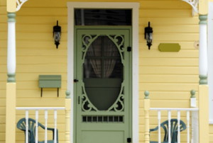 porch of yellow house with screen outside front door