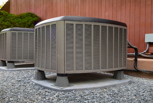 Two heat pumps outside a building