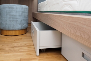 drawers beneath a bed