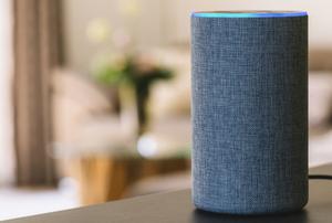 smart home speaker on table in living room