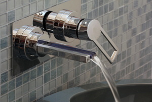 Bathtub waterfall faucet with water pouring out