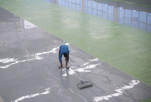 Man applying epoxy flooring