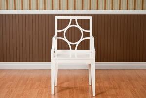 White chair against chair rail.