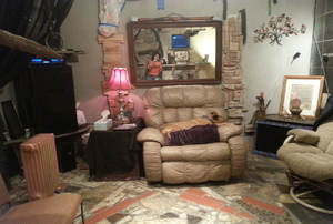 A man cave decorated with stone and granite.