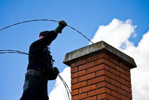 A man works on a chimney.
