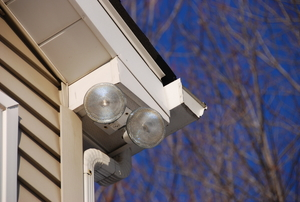 A security flood light installed outside of a home.