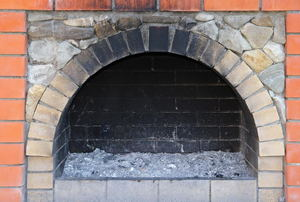 A sooty fireplace hearth.