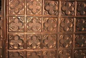 Bronze-colored ceiling tiles.