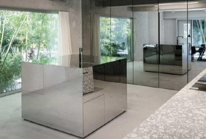modern home with glass furniture and walls
