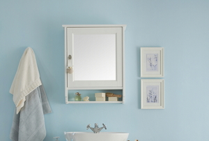 A small, mirrored medicine cabinet in a light blue bathroom.