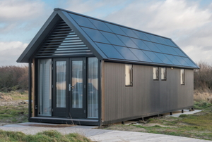 small house with solar panels on the roof