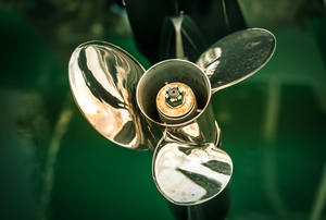 silver boat propeller attached to green boat