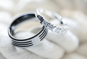 polished wedding rings on white rope