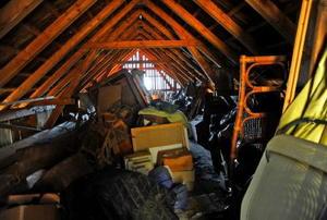 A dingy attic full of junk.