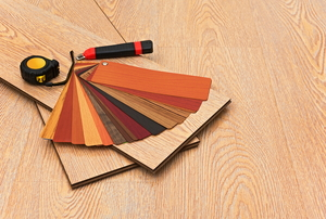 array of laminate faux-wood flooring options, boards, and tools