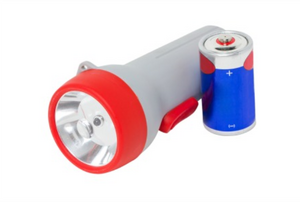 flashlight with battery next to it