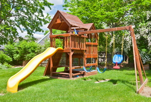 Backyard play structure with slide and swings
