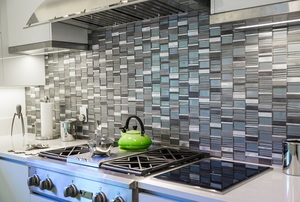 kitchen with metallic tile backsplash