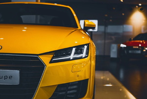 the front of a yellow car