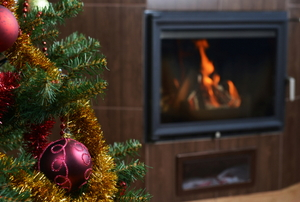 A Christmas tree and fireplace.