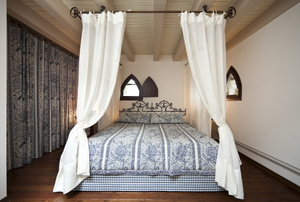 Twin canopy bed with blue comforter
