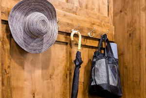 hat, umbrella, and bag hanging on hooks