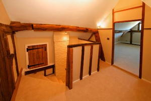 The landing of a finished attic space.