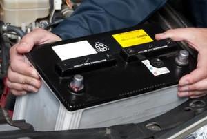 a man removes a car battery
