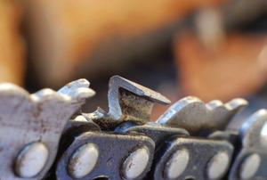 A closeup of a chainsaw chain.