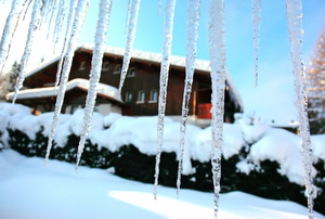 Icicles hang from the eaves on a cold winter morning.