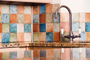 multi-colored tile backsplash in a kitchen
