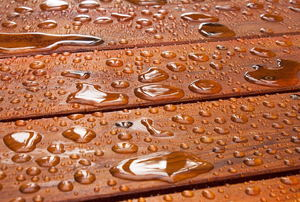 Water beading up on a deck