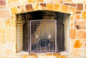 Brick fireplace with metal screen