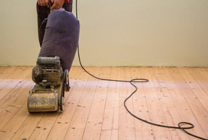 floor sander on a wood floor