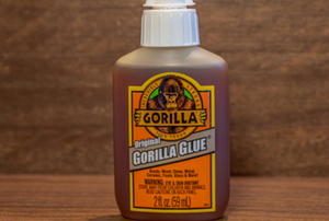 bottle of Gorilla Glue in front of wood surface