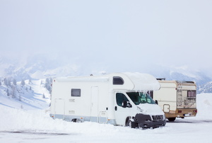 Two RVs in the snow.
