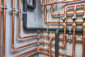 various copper and insulated pipes on walls