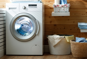 a neat laundry room with a washing machine