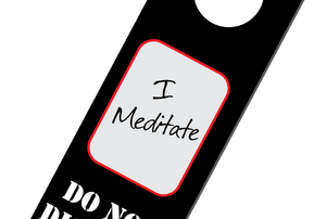 "door knob hanger that reads, ""I meditate, do no disturb"""
