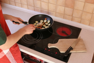 Mixing and cooking food on a cooktop