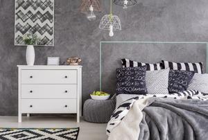 A bedroom with Venetian plaster walls.