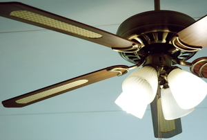A wood ceiling fan.