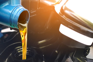 new oil going into a car engine