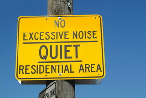 "A ""quiet"" sign in a residential area."