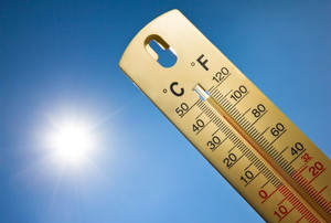thermometer with sun in the background