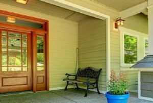 a wood colored fiberglass door on a front porch